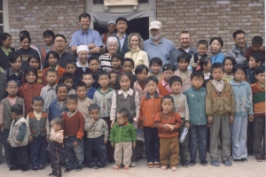 The village children gather around our team.  Shau Hu, our interpreter, is the last adult on the back row at the very right, smiling, wearing glasses.
